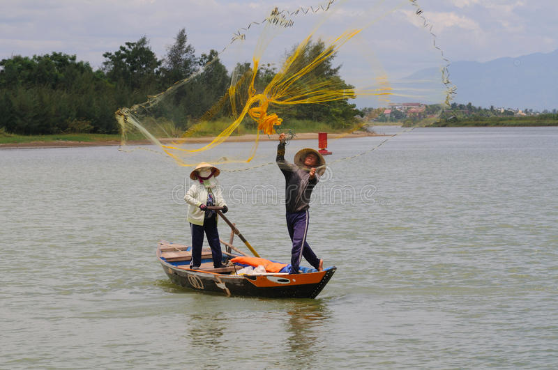 Fisher casting his net stock image