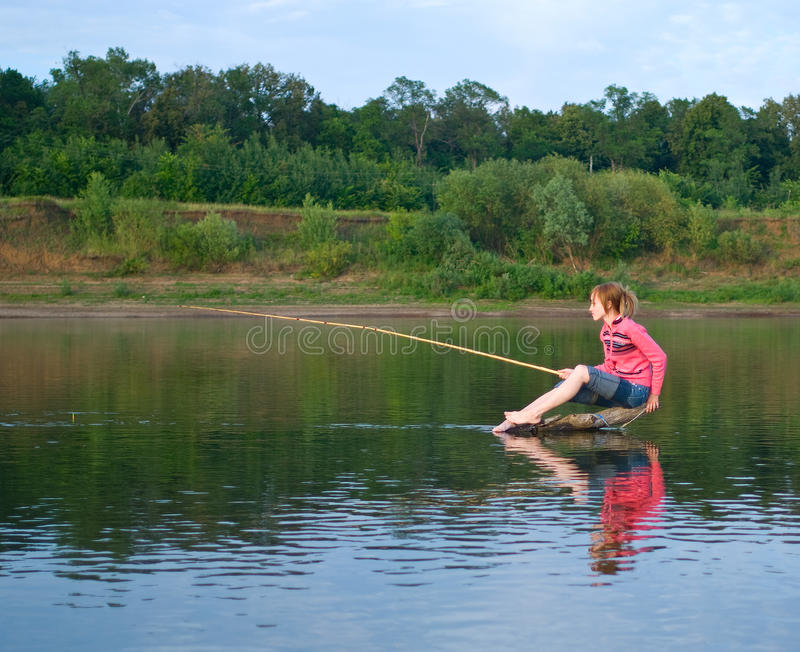 fisher dziewczyny beli środek siedzi fotografia stock