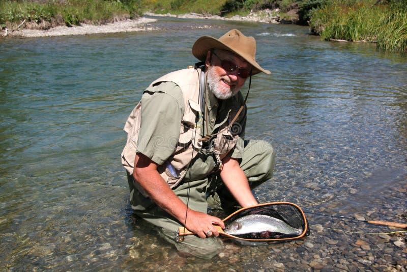 Fisher et arc-en-ciel photos libres de droits