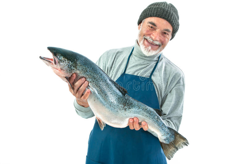 Fisher holding a big atlantic salmon fish. Isolated on white background