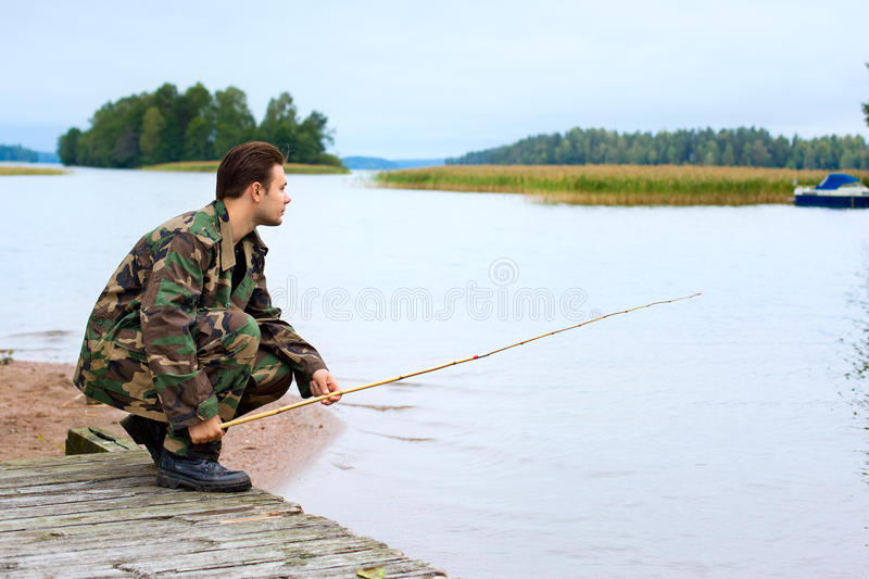 Download Fisher on lake shore stock photo. Image of caucasian - 19798558