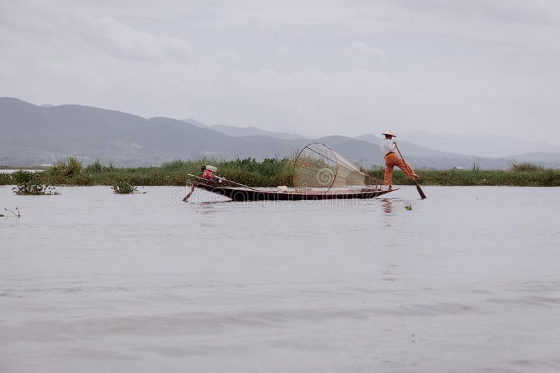 Fisher man in Inlay Lake. Fisher man with leg rower on boat in Inlay Lake, Shan State, Myanmar, October 2018 stock photo