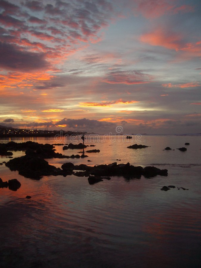 Download Fisher In A Reunion Island Sunrise Stock Image - Image: 4611403