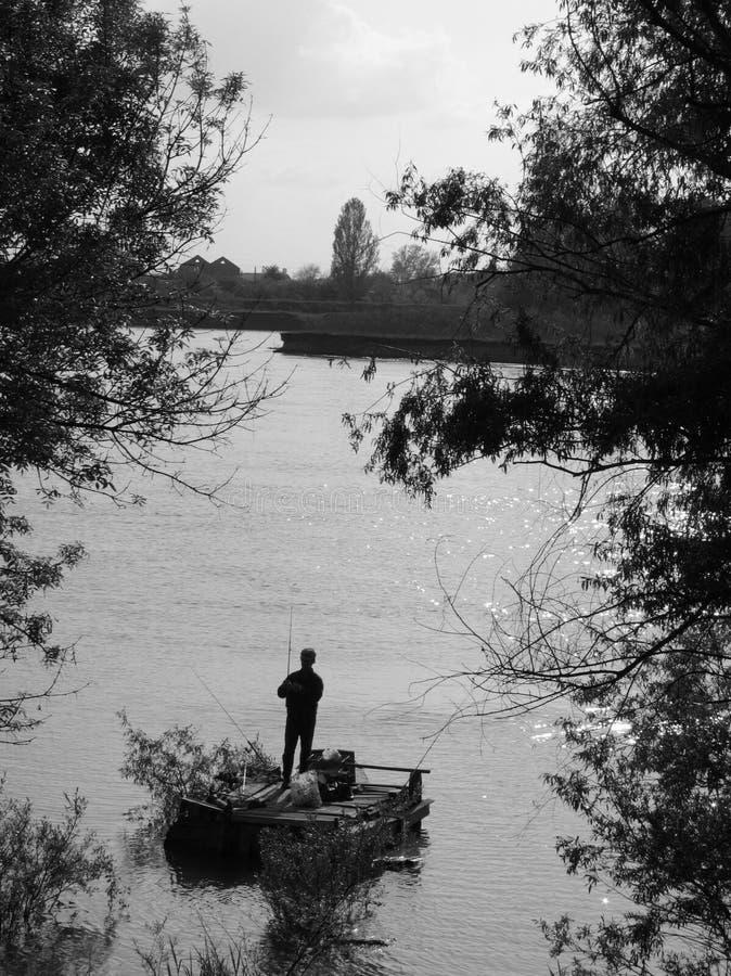 Fisher sul fiume fotografia stock