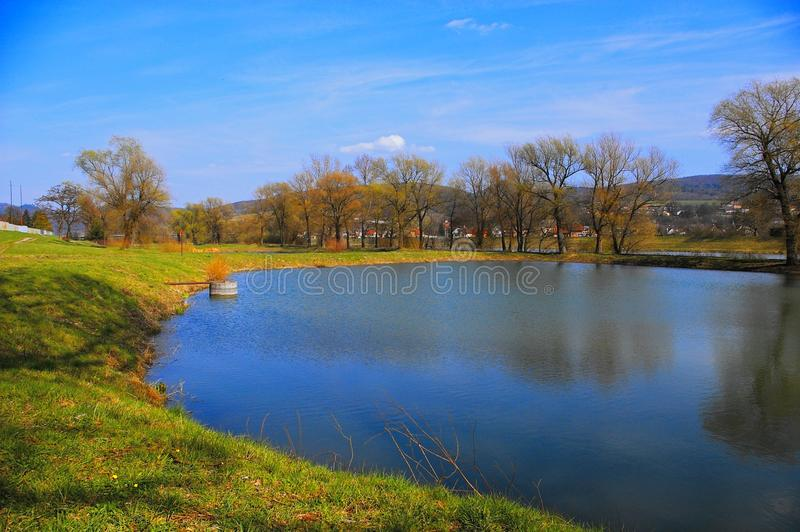 Fisheries pond. Small village fisheries pond on spring, Slovakia royalty free stock image