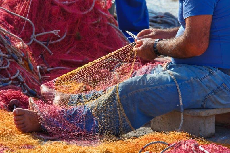 Fisherman. Detail of a fisherman working royalty free stock photos
