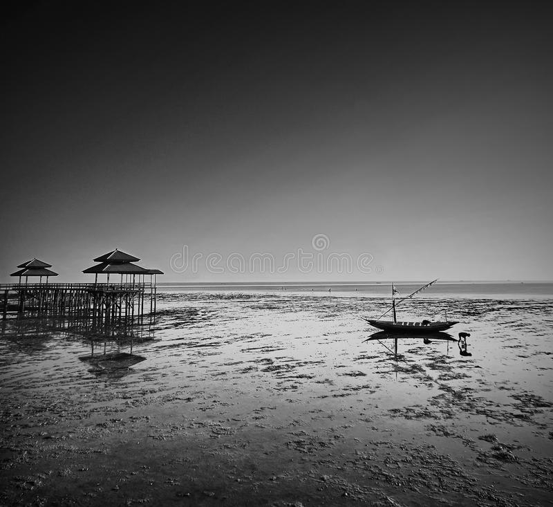 Fisherman activity on receding shore. Taken at Kenjeran beach, Surabaya, east Java, Indonesia stock image