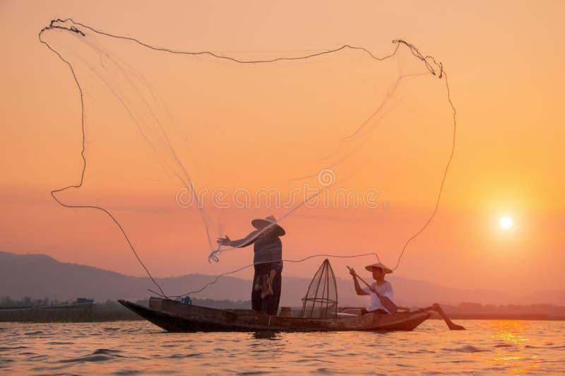 Fisherman of Bangpra Lake in action when fishing stock photo