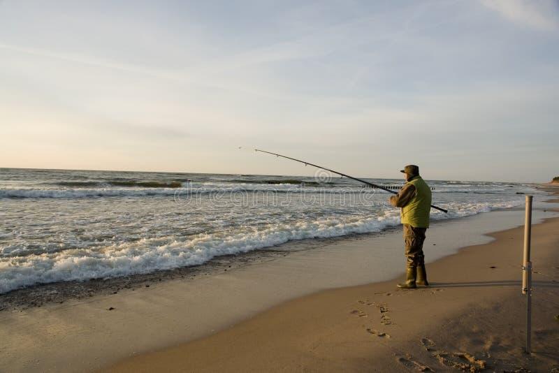 Fisherman on beach stock photography