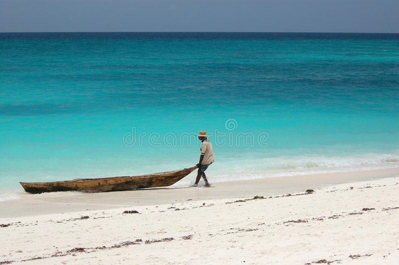 Fisherman on the beach royalty free stock photography