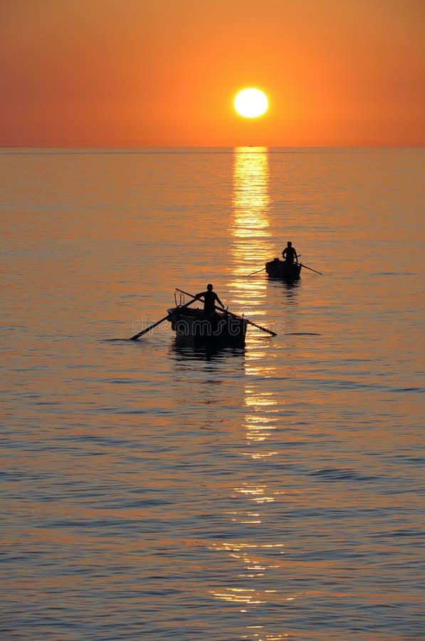 Download Fisherman On Beautiful Calm Bay At Sunrise Stock Photo - Image: 20606136