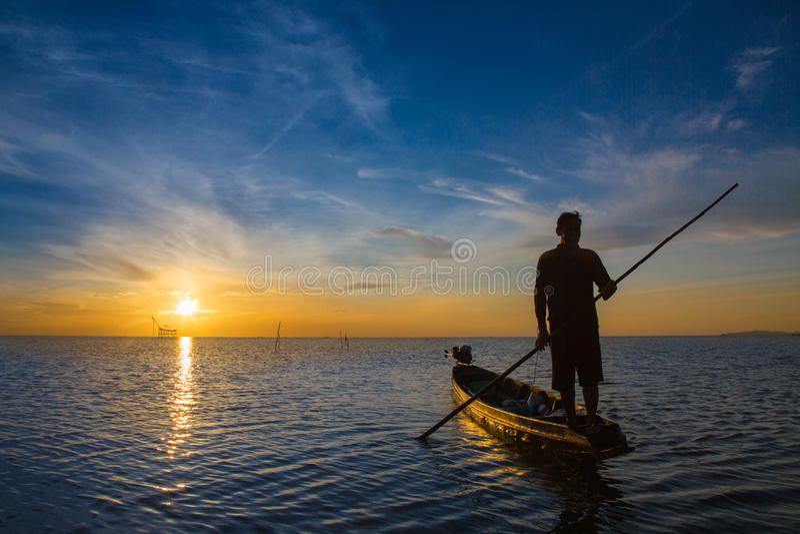 Fisherman with beautiful sunrise stock photo