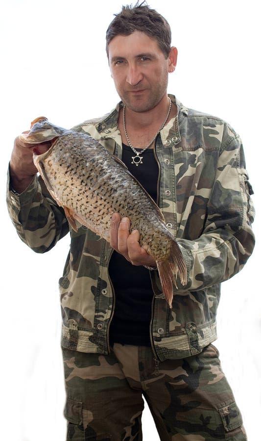 Fisherman with big fish Carp stock photo
