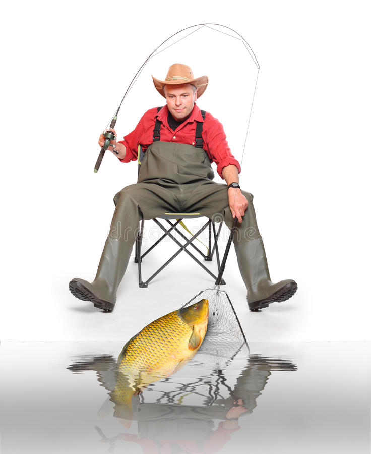 The fisherman. The fisherman with big fish (Common Carp - Cyprinus Carpio). Success concept stock images
