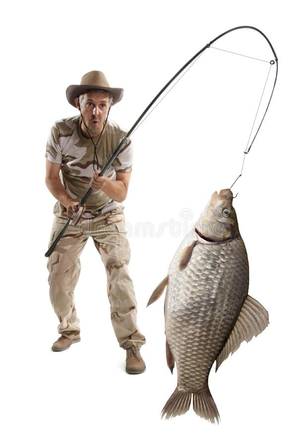Fisherman with big fish. Crucian carp Carassius auratus gibelio stock photography