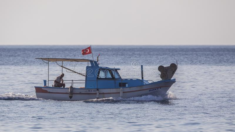 Fisherman Heading Habour stock image