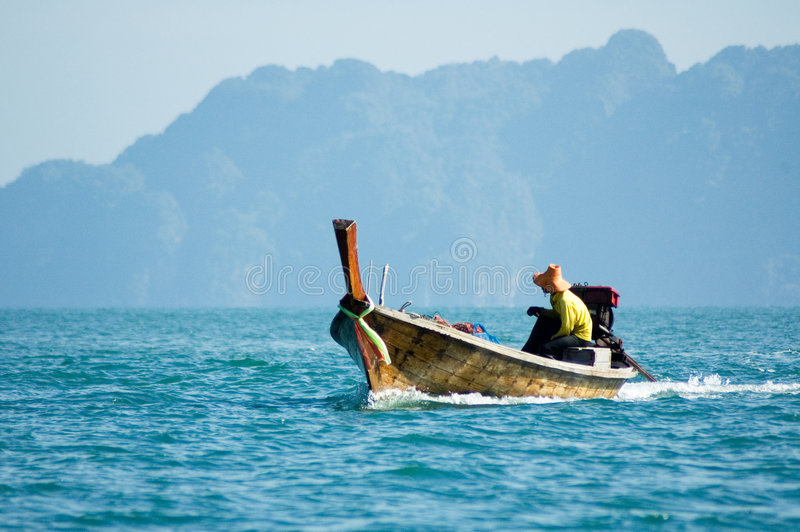 Fisherman in a boat stock image