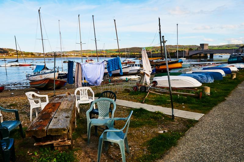 Plastic chair seating setup in harbour Fisherman boat harbour village royalty free stock images