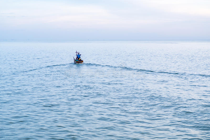 Fisherman on a boat heading out to the sea royalty free stock image