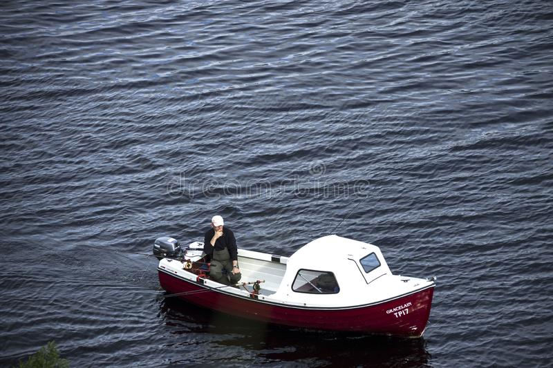 Fisherman in a boat at Loch Ness, Scotland. royalty free stock photos