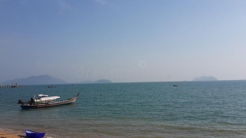 Fisherman boat in the sea royalty free stock photos