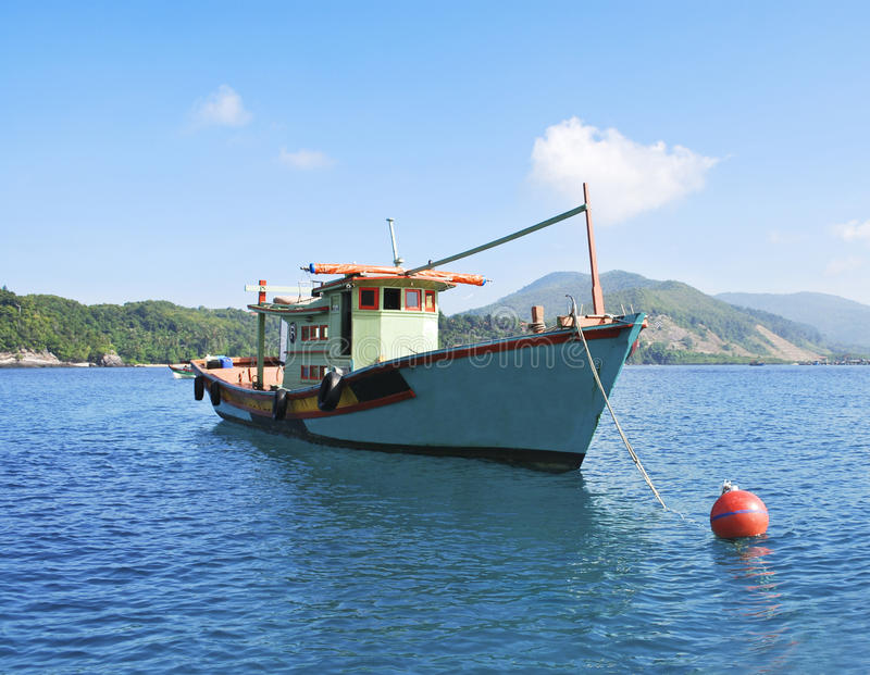 Fisherman boat at seychelles at his moorings royalty free stock image