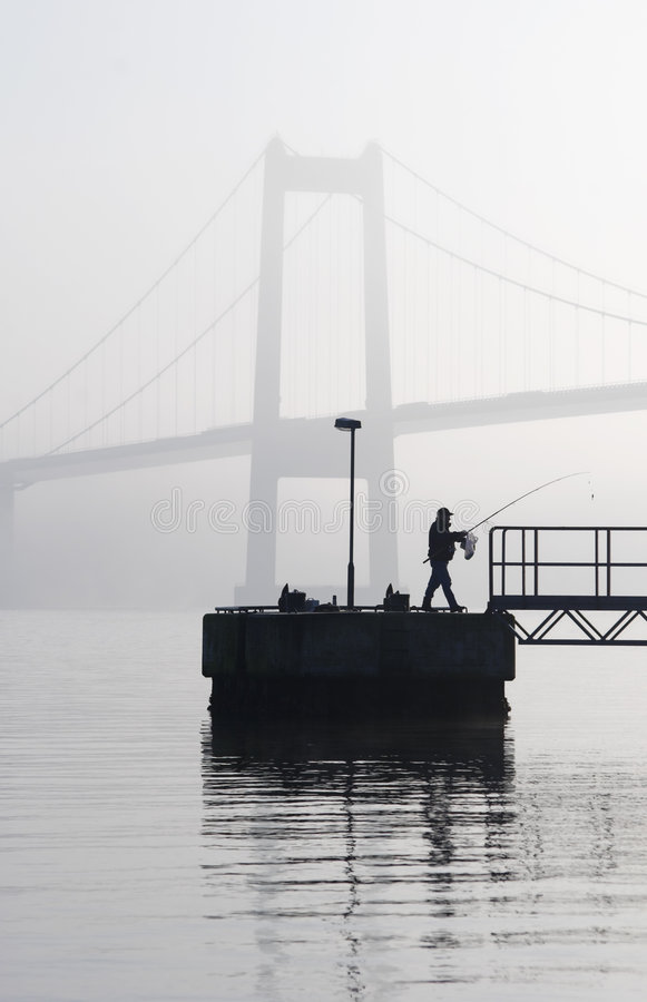 Fisherman and Bridge stock image