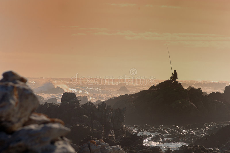 Fisherman at Cape Agulhas royalty free stock photography