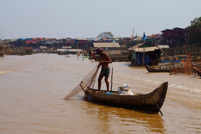 Fisherman casting net stock image