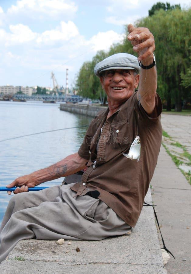 Fisherman caught fishing stock photos