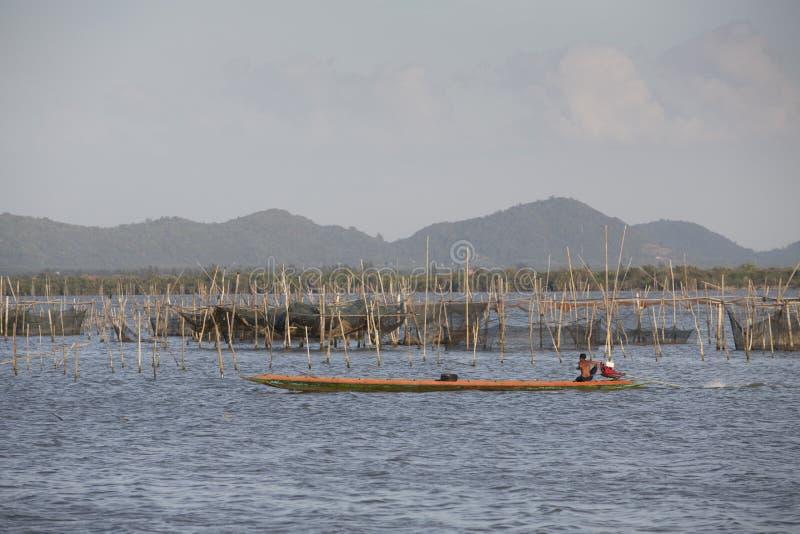 Fisherman crossing a lake royalty free stock image
