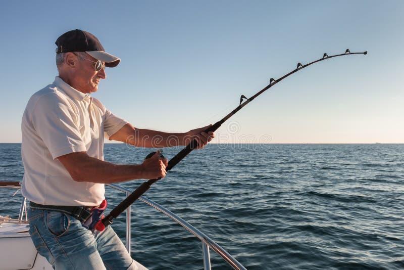 Fisherman fishing royalty free stock photo