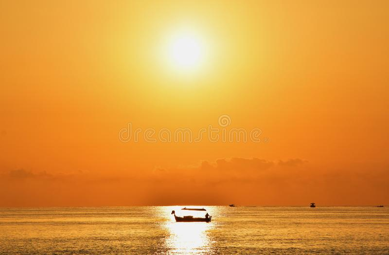 Sunrise & Fishing Boat royalty free stock photography