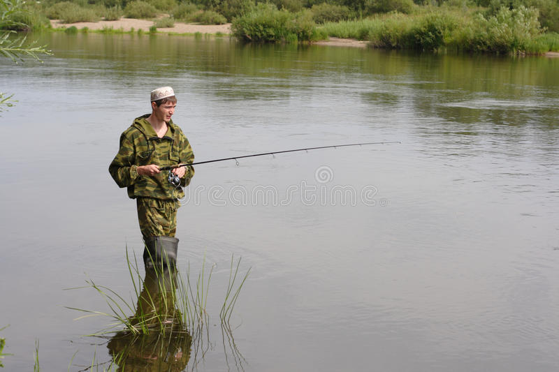 Download Fisherman Fishing On Calm River Stock Photo - Image: 12649506