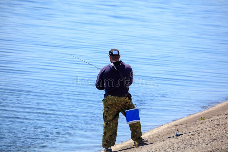The fisherman is fishing on the lake stock image