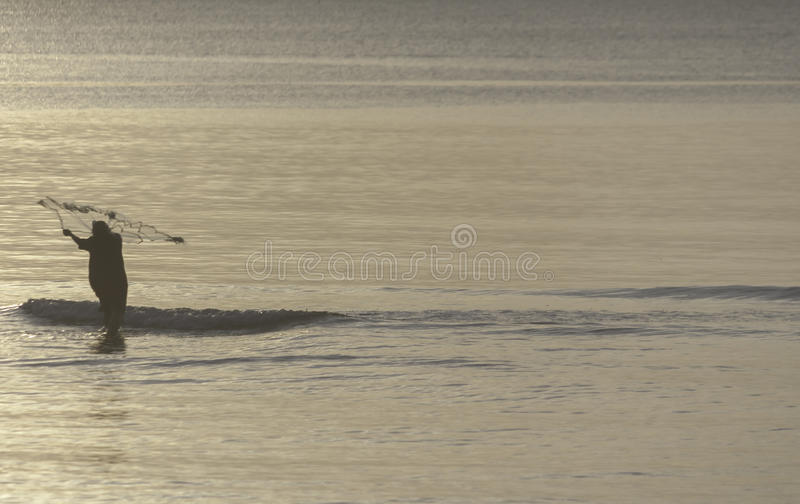 A fisherman fishing in the morning at Thailand gulf royalty free stock image