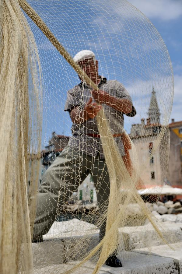 Download Fisherman And A Fishing Net Stock Image - Image: 26321701