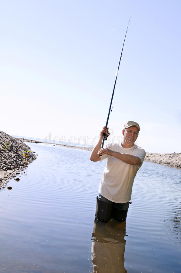 Fisherman fishing on a river. A fisherman fishing on a river royalty free stock photos