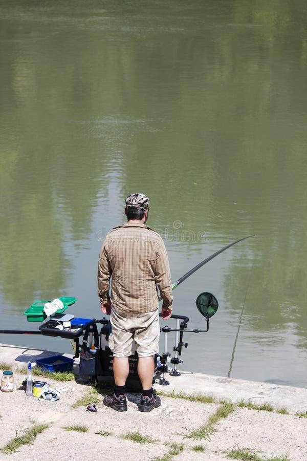 Fisherman fishing in the river Tiber stock image