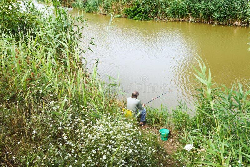 Fisherman is fishing on riverbank. Kuban, Russia royalty free stock images
