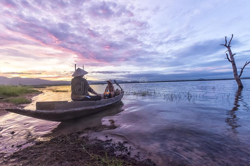 Fisherman grandfather and grandson fishing on the boat, Family a royalty free stock images