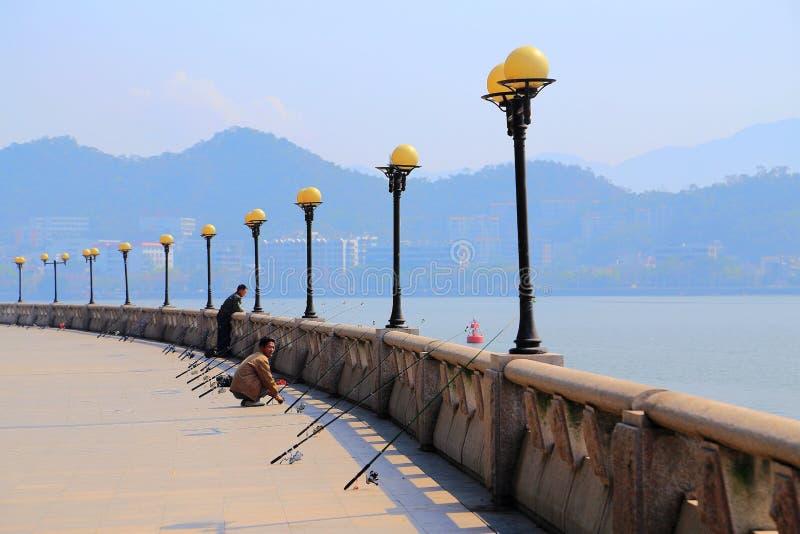 The Fisherman on Guangji Bridge royalty free stock image