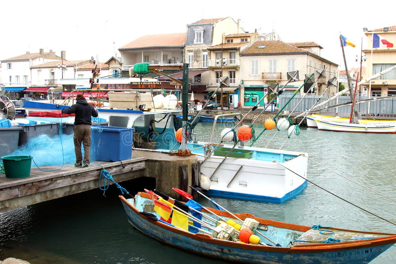 Fisherman in the harbour of Le Grau-du-Roi, France royalty free stock photography