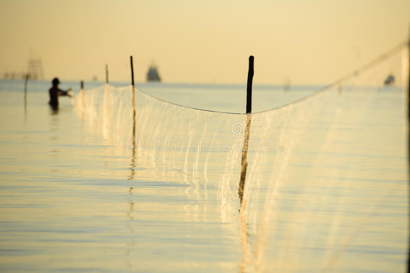 The fisherman and his net stock photography
