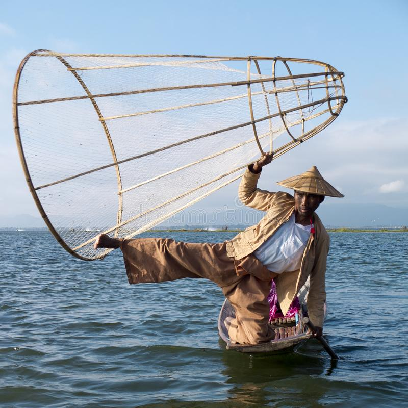 Fisherman holding the traditional conical net royalty free stock image