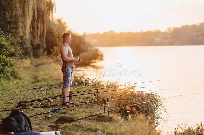Fisherman imports bait by boat on lake for fishing stock photo