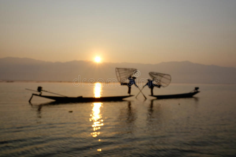 Fisherman of Inle Lake in action when fishing stock images