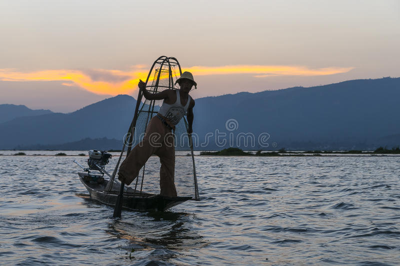 Fisherman on the Inle lake in Myanmar. Time of Sunset. royalty free stock photography