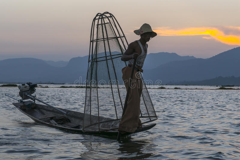 Fisherman on the Inle lake in Myanmar. Time of Sunset. royalty free stock photos