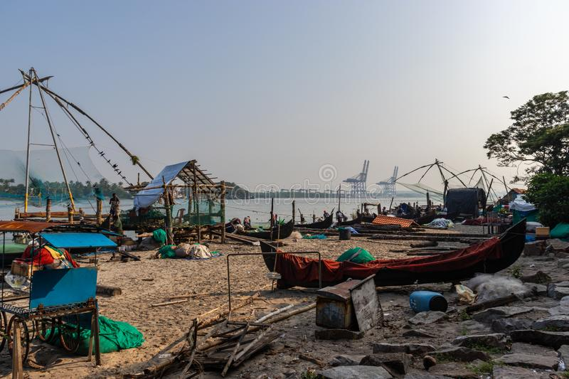 Fisherman and its Fishing nets in the morning hours stock photos